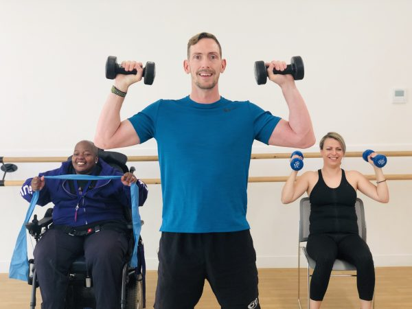 An image of Dom Thorpe exercising with people with Multiple sclerosis and other disabilities